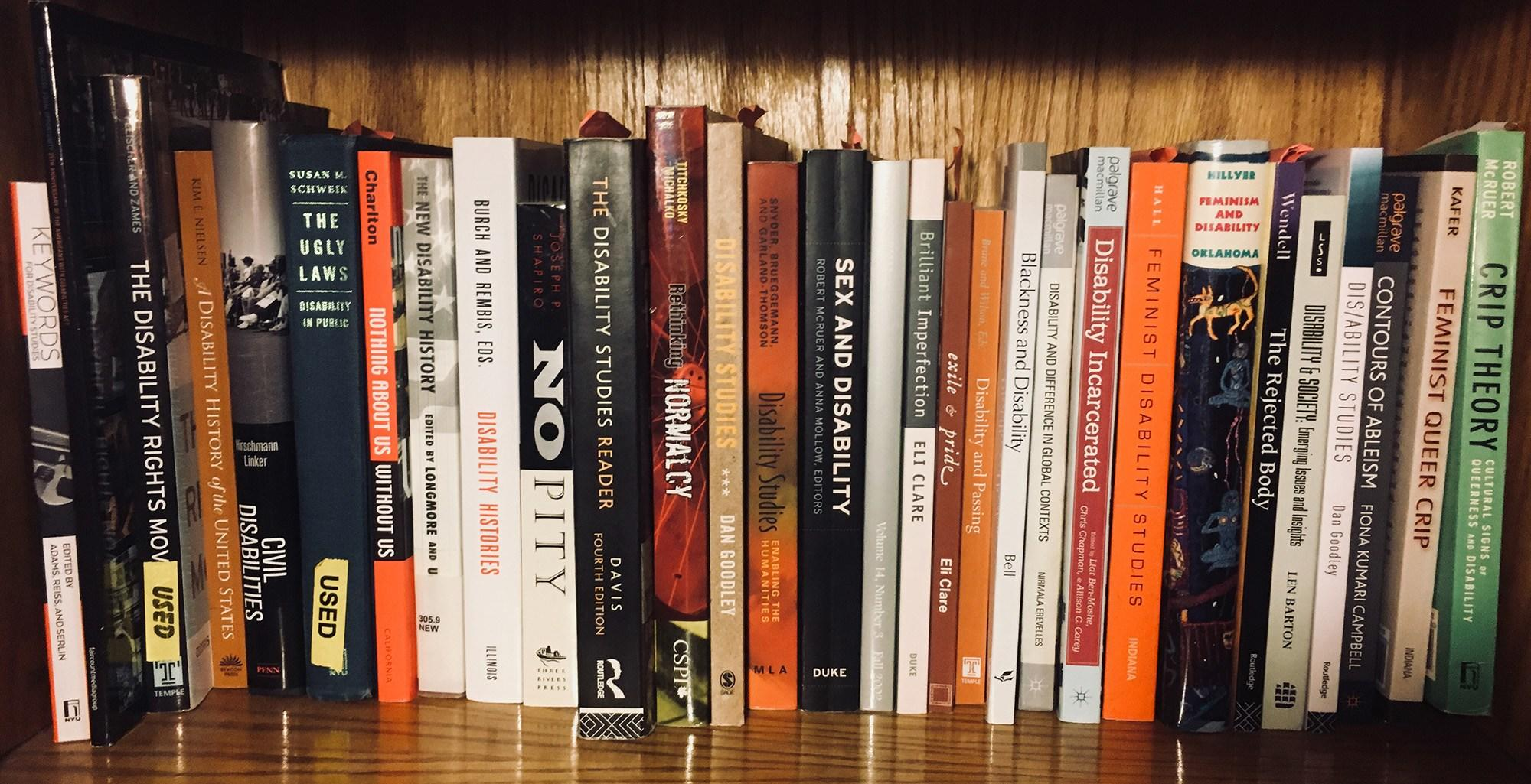 Bookshelf with books on critical disability studies